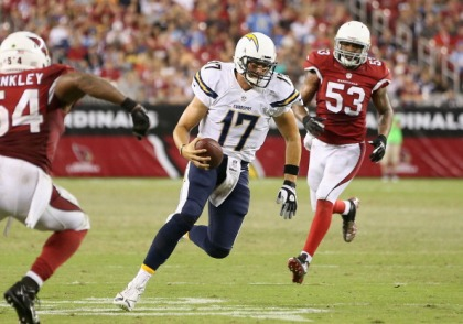 GLENDALE, AZ - AUGUST 24: Quarterback Philip Rivers #17 of the San Diego Chargers scrambles with the football during the preseason NFL game against the Arizona Cardinals at the University of Phoenix Stadium on August 24, 2013 in Glendale, Arizona. (Photo by Christian Petersen/Getty Images)
