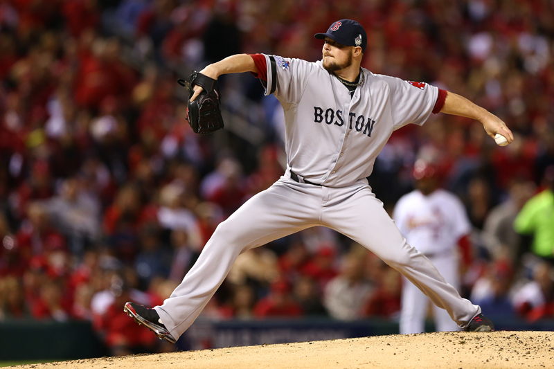 ST LOUIS, MO - OCTOBER 28: Jon Lester #31 of the Boston Red Sox pitches against the St. Louis Cardinals during Game Five of the 2013 World Series at Busch Stadium on October 28, 2013 in St Louis, Missouri.