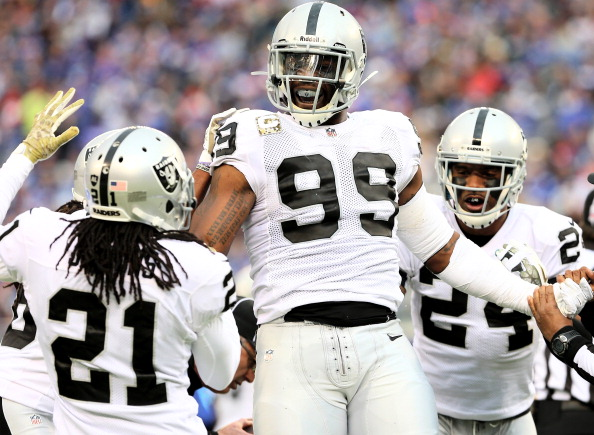 EAST RUTHERFORD, NJ - NOVEMBER 10: Lamarr Houston #99 of the Oakland Raiders celebrates after he recovers a fumble by Peyton Hillis of the New York Giants at MetLife Stadium on November 10, 2013 in East Rutherford, New Jersey. (Photo by Elsa/Getty Images)