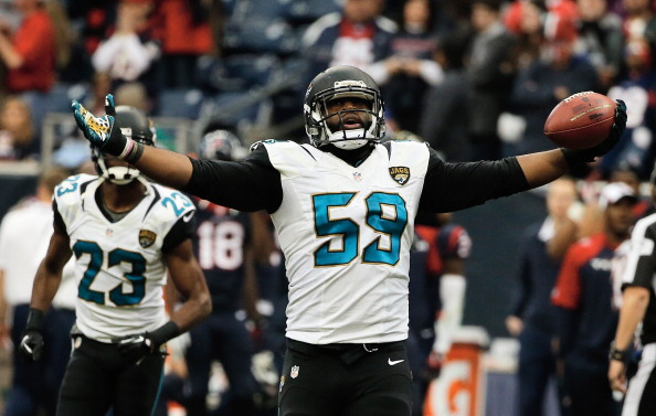 HOUSTON, TX - NOVEMBER 24:  Ryan Davis #59 of the Jacksonville Jaguars celebrates after intercepting a pass late in the fourth quarter of the game against the Houston Texans at Reliant Stadium on November 24, 2013 in Houston, Texas.  (Photo by Scott Halleran/Getty Images)