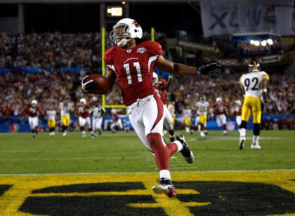 TAMPA, FL - FEBRUARY 01:  Wide receiver Larry Fitzgerald #11 of the Arizona Cardinals celebrates as he scores a 64-yard touchdown reception in the fourth quarter against the Pittsburgh Steelers during Super Bowl XLIII on February 1, 2009 at Raymond James Stadium in Tampa, Florida.