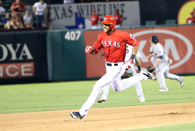 ARLINGTON, TX - SEPTEMBER 23: Alex Rios #51 of the Texas Rangers rounds second base after hitting an RBI triple in the sixth inning to complete a cycle during a game against the Houston Astros at Rangers Ballpark in Arlington on September 23, 2013 in Arlington, Texas. Rios hit a two-run double in the first inning, a single in the third, and a solo home run in the fourth.