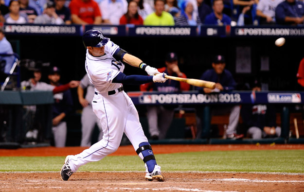 ST PETERSBURG, FL - OCTOBER 07: Evan Longoria #3 of the Tampa Bay Rays flies out to center in the ninth inning against the Boston Red Sox during Game Three of the American League Division Series at Tropicana Field on October 7, 2013 in St Petersburg, Florida.