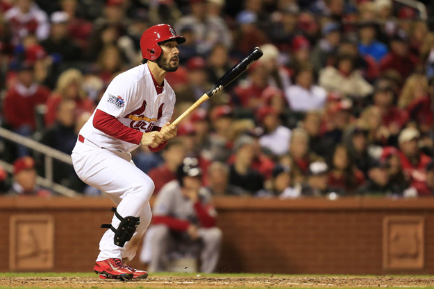 ST LOUIS, MO - OCTOBER 27:  Matt Carpenter #13 hits a single to right field against Craig Breslow #32 of the Boston Red Sox in the seventh inning scoring Shane Robinson #43 during Game Four of the 2013 World Series at Busch Stadium on October 27, 2013 in St Louis, Missouri.