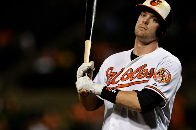 BALTIMORE, MD - AUGUST 19: Matt Wieters #32 of the Baltimore Orioles reacts after striking out against the Tampa Bay Rays in the eighth inning at Oriole Park at Camden Yards on August 19, 2013 in Baltimore, Maryland. The Tampa Bay Rays won, 4-3.