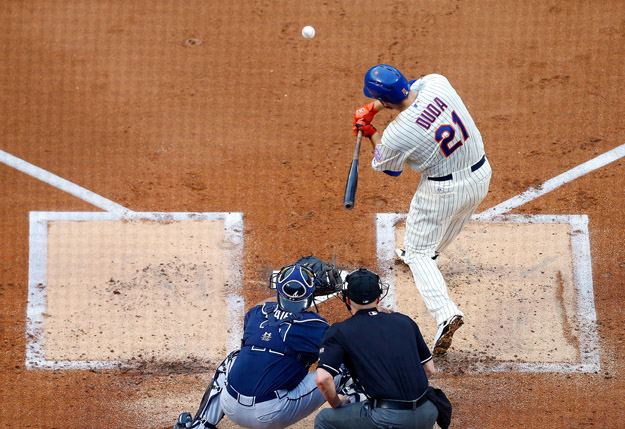NEW YORK, NY - JULY 09:  Lucas Duda #21 of the New York Mets connects on a first-inning RBI base hit against the Atlanta Braves at Citi Field on July 9, 2014 in the Flushing neighborhood of the Queens borough of New York City.