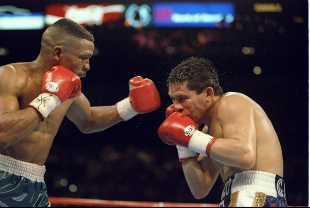 rankie Randall (left) trades blows with his opponent  Julio Cesar Chavez