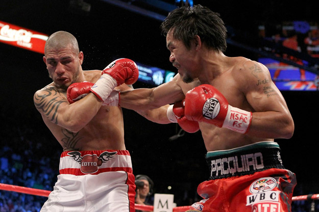 Manny Pacquiao throws a right to the head of Miguel Cotto.