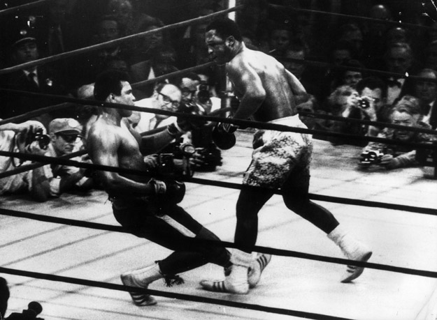 Muhammad Ali goes down in the 15th round to a left hook from world heavyweight champion Joe Frazier.