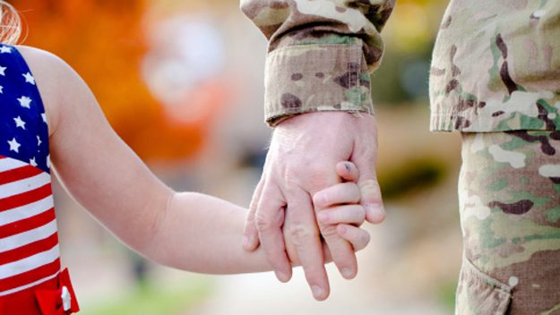 Child With Army Officer (Photo Credit: Thinkstock)