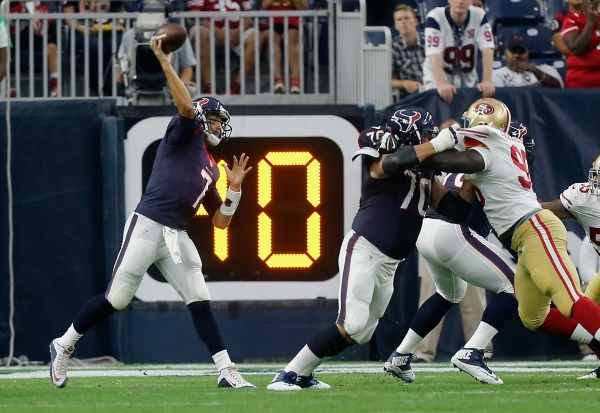 HOUSTON, TX - AUGUST 15: Brian Hoyer #7 of the Houston Texans throws a pass in the first quarter against the San Francisco 49ers in a preseason game at Reliant Arena at Reliant Park on August 15, 2015 in Houston, Texas. (Photo by Bob Levey/Getty Images)