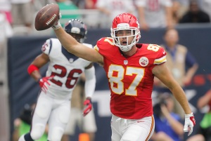 HOUSTON, TX - SEPTEMBER 13: Travis Kelce #87 of the Kansas City Chiefs celebrates after catching a touchdown pass against Rahim Moore #26 of the Houston Texans in the first quarter in a NFL game on September 13, 2015 at NRG Stadium in Houston, Texas. (Photo by Bob Levey/Getty Images)