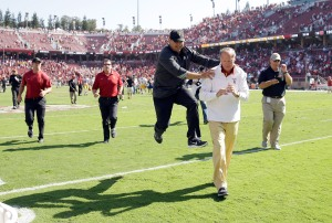 PALO ALTO, CA - SEPTEMBER 06:  USC head coach Steve Sarkisian jumps in celebration with Athletic Director Pat Haden after they beat the Stanford Cardinal at Stanford Stadium on September 6, 2014 in Palo Alto, California.  (Photo by Ezra Shaw/Getty Images)