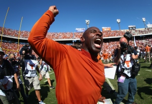 DALLAS, TX - OCTOBER 10:  Head coach Charlie Strong of the Texas Longhorns celebrates after the Longhorns beat the Oklahoma Sooners 24-17 during the AT&T Red River Showdown at the Cotton Bowl on October 10, 2015 in Dallas, Texas.  (Photo by Tom Pennington/Getty Images)