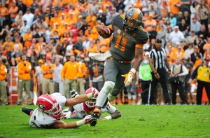 KNOXVILLE, TN - OCTOBER 10: Joshua Dobbs #11 of the Tennessee Volunteers breaks away for a touchdown from a tackle attempt by Jake Ganus #51 of the Georgia Bulldogs on October 10, 2015 at Neyland Stadium in Knoxville, Tennessee. (Photo by Scott Cunningham/Getty Images)