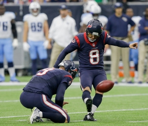 HOUSTON, TX - NOVEMBER 01: Nick Novak #8 of the Houston Texans kicks a 38 yard field goal out the hold of Shane Lechler #9 in the second quarter against the Tennessee Titans at Reliant Park on November 1, 2015 in Houston, Texas. (Photo by Bob Levey/Getty Images)