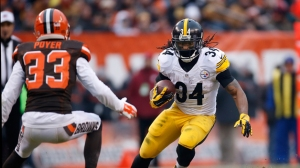 CLEVELAND, OH - JANUARY 3: DeAngelo Williams #34 of the Pittsburgh Steelers carries the ball in front of the defense of Jordan Poyer #33 of the Cleveland Browns during the second quarter at FirstEnergy Stadium on January 3, 2016 in Cleveland, Ohio. (Photo by Gregory Shamus/Getty Images)