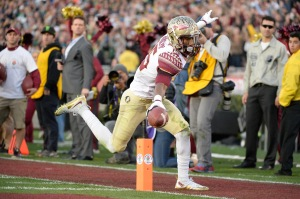 PASADENA, CA - JANUARY 01: Wide receiver Travis Rudolph #15 of the Florida State Seminoles scores on a 18-yard pass from quarterback Jameis Winston #5 in the third quarter of the College Football Playoff Semifinal against the Oregon Ducks at the Rose Bowl Game presented by Northwestern Mutual at the Rose Bowl on January 1, 2015 in Pasadena, California. (Photo by Harry How/Getty Images)