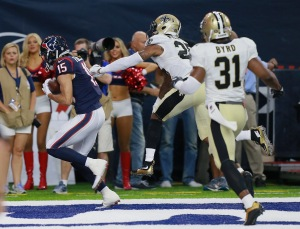 HOUSTON, TX - AUGUST 20: Will Fuller #15 of the Houston Texans catches a pass for a touchdown in the first quarter as he beats P.J. Williams #25 of the New Orleans Saints and Jairus Byrd #31 during a preseason NFL game at NRG Stadium on August 20, 2016 in Houston, Texas. (Photo by Bob Levey/Getty Images)