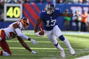 EAST RUTHERFORD, NJ - SEPTEMBER 25: Odell Beckham #13 of the New York Giants breaks a tackle by Josh Norman #24 of the Washington Redskins in the second half at MetLife Stadium on September 25, 2016 in East Rutherford, New Jersey. (Photo by Michael Reaves/Getty Images)
