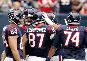 HOUSTON, TX - OCTOBER 2: Brock Osweiler #17 of the Houston Texans celebrates with C.J. Fiedorowicz #87 of the Houston Texans and teammates after a touchdown in the first quarter of the NFL game at NRG Stadium on October 2, 2016 in Houston, Texas. (Photo by Thomas B. Shea/Getty Images)