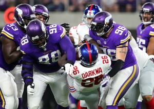 MINNEAPOLIS, MN - OCTOBER 3: Linval Joseph #98 and Brian Robison #96 of the Minnesota Vikings tackle ball carrier Orleans Darkwa #26 of the New York Giants in the first half of the game on October 3, 2016 at US Bank Stadium in Minneapolis, Minnesota. (Photo by Adam Bettcher/Getty Images)