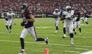 HOUSTON, TX - OCTOBER 2: Will Fuller #15 of the Houston Texans returns a punt for 67 yards and a touchdown as Tennessee Titans defenders pursue in the third quarter during the NFL game between the Tennessee Titans and the Houston Texans at NRG Stadium on October 2, 2016 in Houston, Texas. (Photo by Bob Levey/Getty Images)