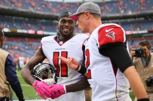 DENVER, CO - OCTOBER 9: Wide receiver Julio Jones #11 and quarterback Matt Ryan #2 of the Atlanta Falcons talk after defeating the Denver Broncos 23-16 at Sports Authority Field at Mile High on October 9, 2016 in Denver, Colorado. (Photo by Justin Edmonds/Getty Images)