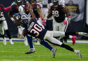 HOUSTON, TX - OCTOBER 16: Kevin Johnson #30 of the Houston Texans breaks up pass intended for Phillip Dorsett #15 of the Indianapolis Colts in the fourth quarter at NRG Stadium on October 16, 2016 in Houston, Texas. (Photo by Bob Levey/Getty Images)