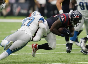 HOUSTON, TX - OCTOBER 30: Lamar Miller #26 of the Houston Texans is tackled by Glover Quin #27 of the Detroit Lions in the third quarter at NRG Stadium on October 30, 2016 in Houston, Texas. (Photo by Thomas B. Shea/Getty Images)