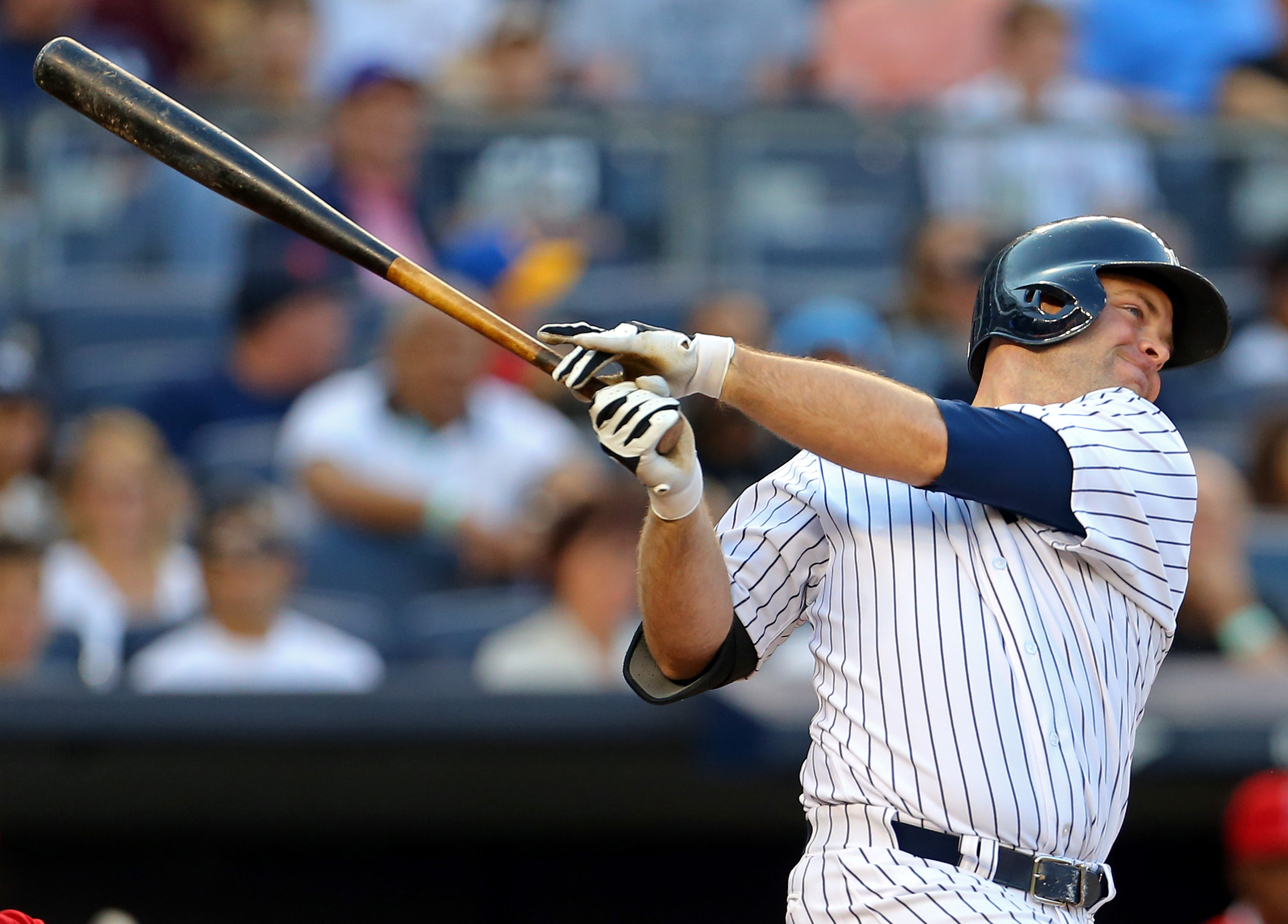 NEW YORK, NY - JUNE 6: Brian McCann #34 of the New York Yankees hits a 2-run home run against the Los Angeles Angels of Anaheim during the first inning at Yankee Stadium on June 6, 2015 in the Bronx borough of New York City. (Photo by Adam Hunger/Getty Images)