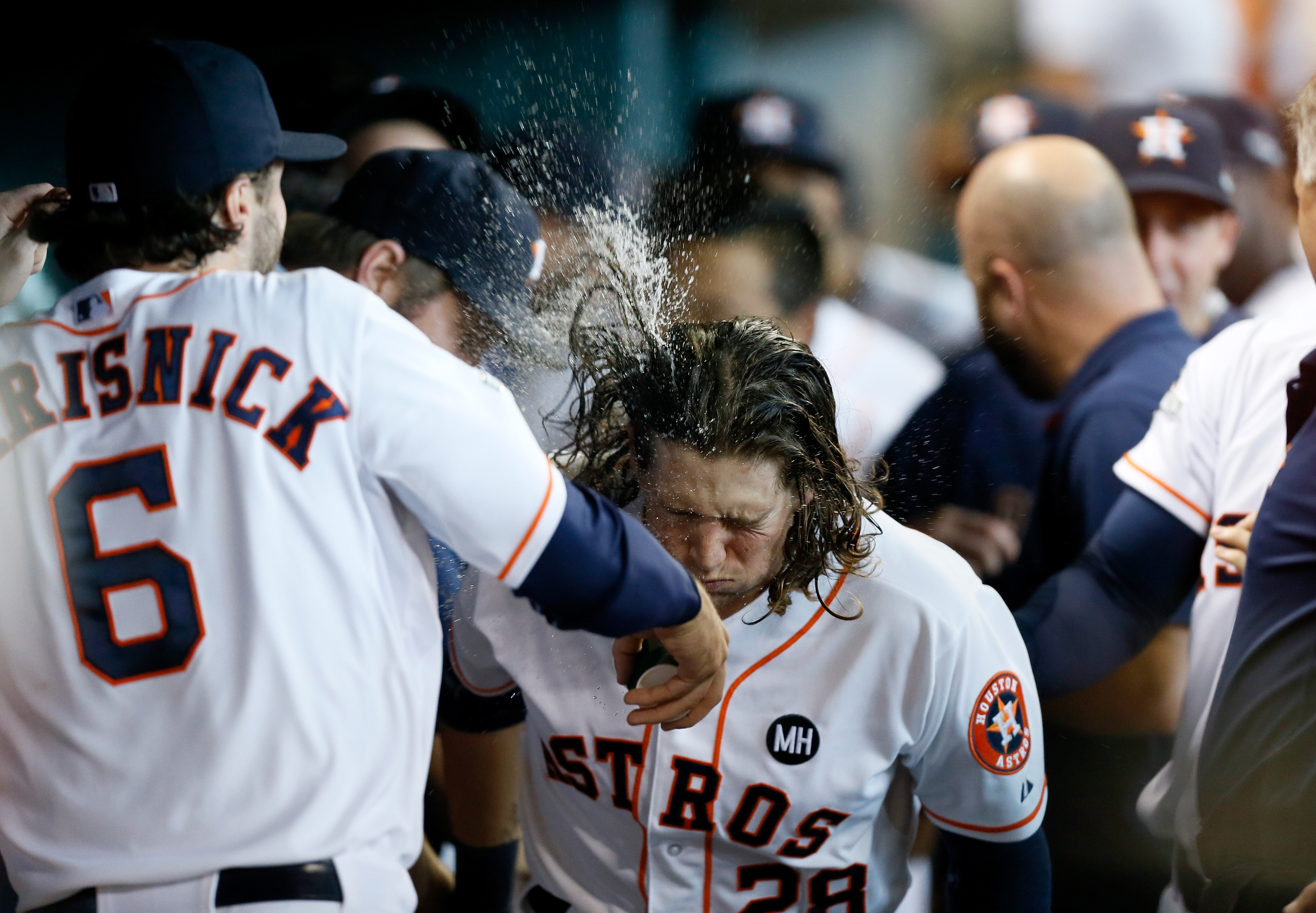 HOUSTON, TX - OCTOBER 12: Colby Rasmus #28 of the Houston Astros celebrates his seventh inning solo home run as Jake Marisnick #6 throws water on him against the Kansas City Royals during game four of the American League Divison Series at Minute Maid Park on October 12, 2015 in Houston, Texas. (Photo by Bob Levey/Getty Images)