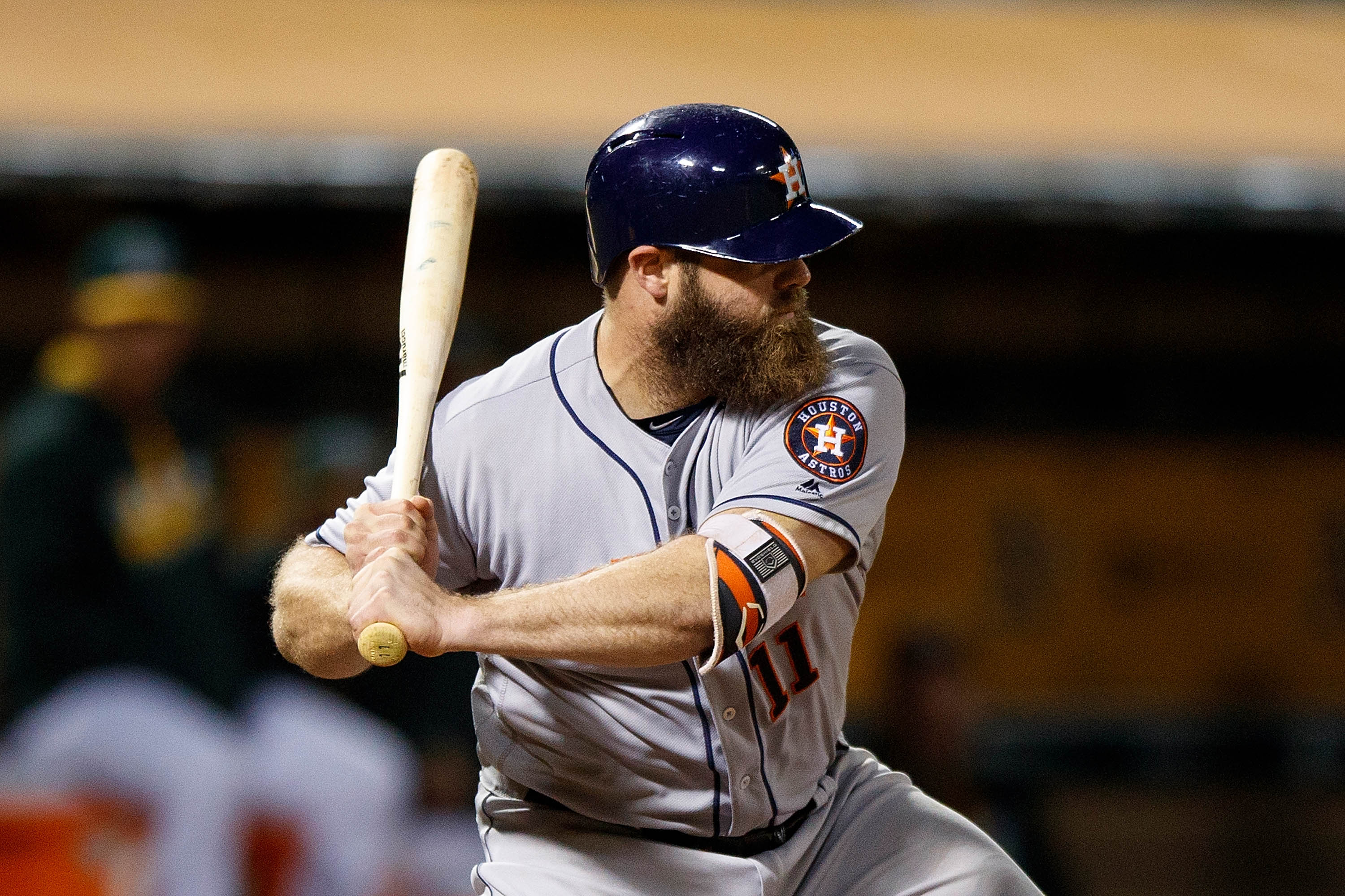 OAKLAND, CA - SEPTEMBER 20: Evan Gattis #11 of the Houston Astros at bat against the Oakland Athletics during the ninth inning at the Oakland Coliseum on September 20, 2016 in Oakland, California. The Houston Astros defeated the Oakland Athletics 2-1 in 10 innings. (Photo by Jason O. Watson/Getty Images)