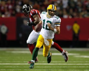 ATLANTA, GA - OCTOBER 30: Aaron Rodgers #12 of the Green Bay Packers rushes awau Dwight Freeney #93 of the Atlanta Falcons at Georgia Dome on October 30, 2016 in Atlanta, Georgia. (Photo by Kevin C. Cox/Getty Images)