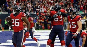 HOUSTON, TX - DECEMBER 18: Lamar Miller #26 of the Houston Texans celebrates his score along with Jay Prosch #45 at NRG Stadium on December 18, 2016 in Houston, Texas. (Photo by Bob Levey/Getty Images)